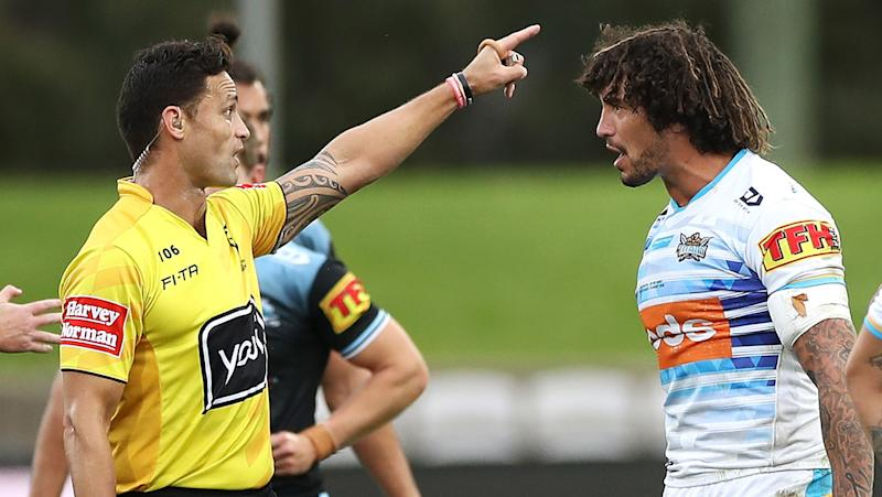 Kevin Proctor is pictured being sent off by referee Henry Perenara after allegedly biting Cronulla opponent Shaun Johnson.