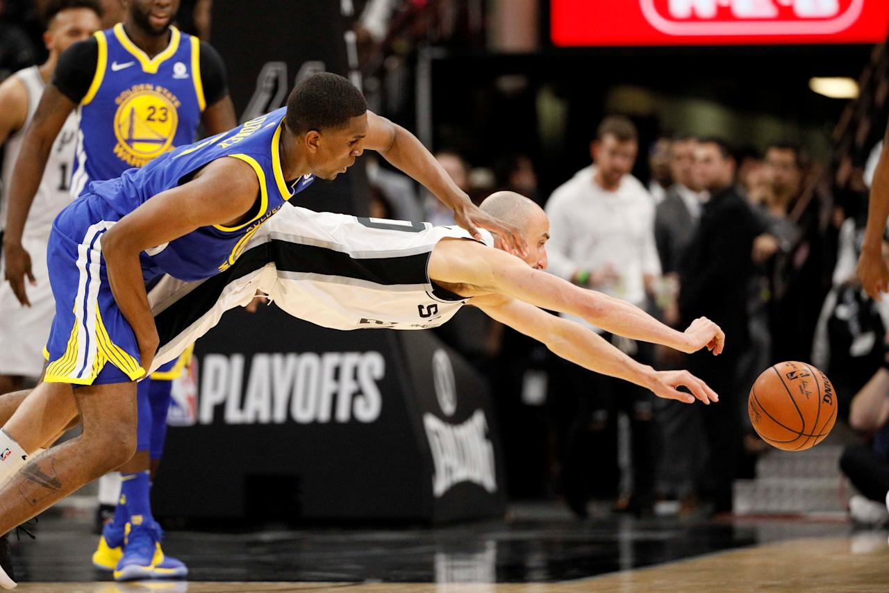 Apr 19, 2018; San Antonio, TX, USA; San Antonio Spurs shooting guard Manu Ginobili (20) dives for the loose ball Golden State Warriors small forward Kevon Looney (left) in game three of the first round of the 2018 NBA Playoffs at AT&T Center. Mandatory Credit: Soobum Im-USA TODAY Sports     TPX IMAGES OF THE DAY