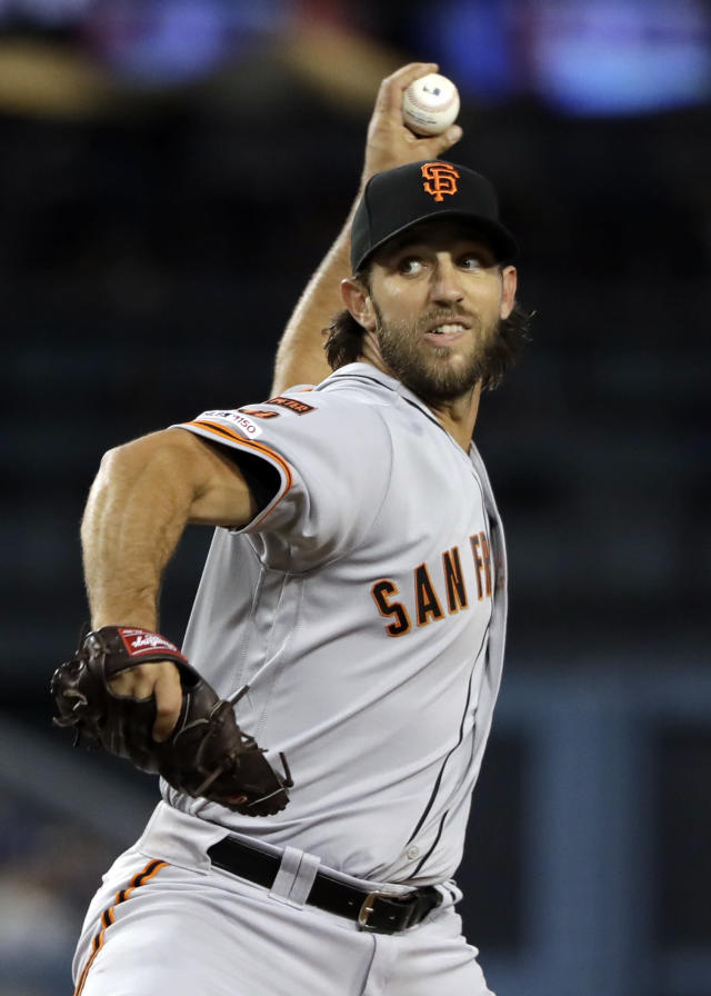 San Francisco Giants starting pitcher Madison Bumgarner throws to the Los Angeles Dodgers during the third inning of a baseball game Tuesday, April 2, 2019, in Los Angeles. (AP Photo/Marcio Jose Sanchez)
