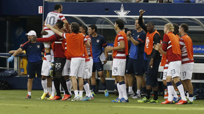 United States' Landon Donovan (10) is congratulated by teammates after scoring a goal against Honduras during the first half of the Gold Cup semifinals at Cowboys Stadium, Wednesday, July 24, 2013, in Arlington, Texas. (AP Photo/Brandon Wade)