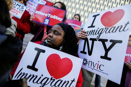 Haitian immigrants and supporters rally to reject DHS Decision to terminate TPS for Haitians, at the Manhattan borough in New York, U.S., November 21, 2017.  REUTERS/Eduardo Munoz