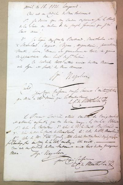 A copy of Napoleon's will is displayed at an auction house in Paris, France, Tuesday, Nov. 5, 2013. On Wednesday, the only known copy of this testament is being sold by Paris' Drouot Auction house. The original is in France's national archives. The copy, written by a close adviser, is expected to fetch 120,000 euros ($162,000). The 51-year-old Napoleon died in 1821 in exile on Saint Helena island, 19 days after penning the will. (AP Photo/Benjamin Girette)