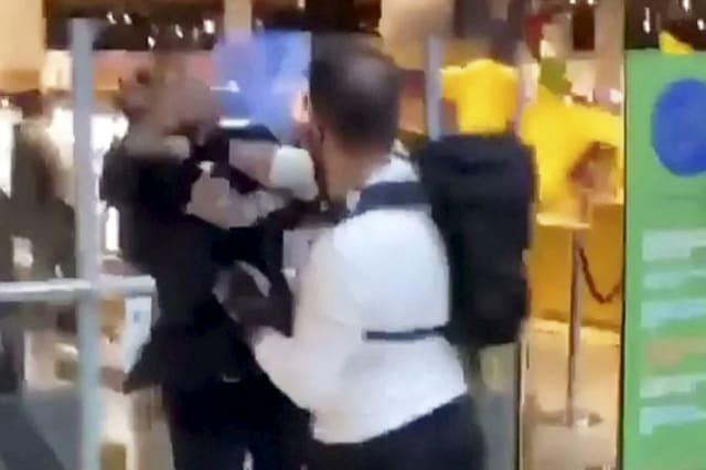 Shocking footage shows security guard and raging shopper come to blows outside Selfridges store