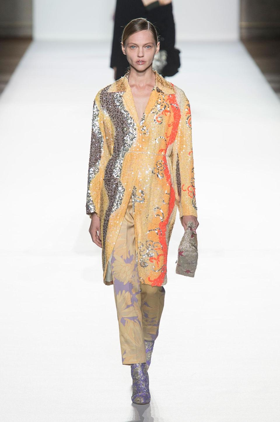 <p>A dreamy orange, yellow, and silver sequin coat from the SS18 Dries Van Noten collection. (Photo: ImaxTree) </p>