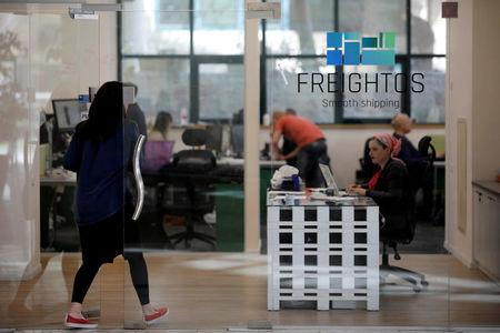 FILE PHOTO: A woman enters the offices of Freightos, an online marketplace for international shipping, in Jerusalem