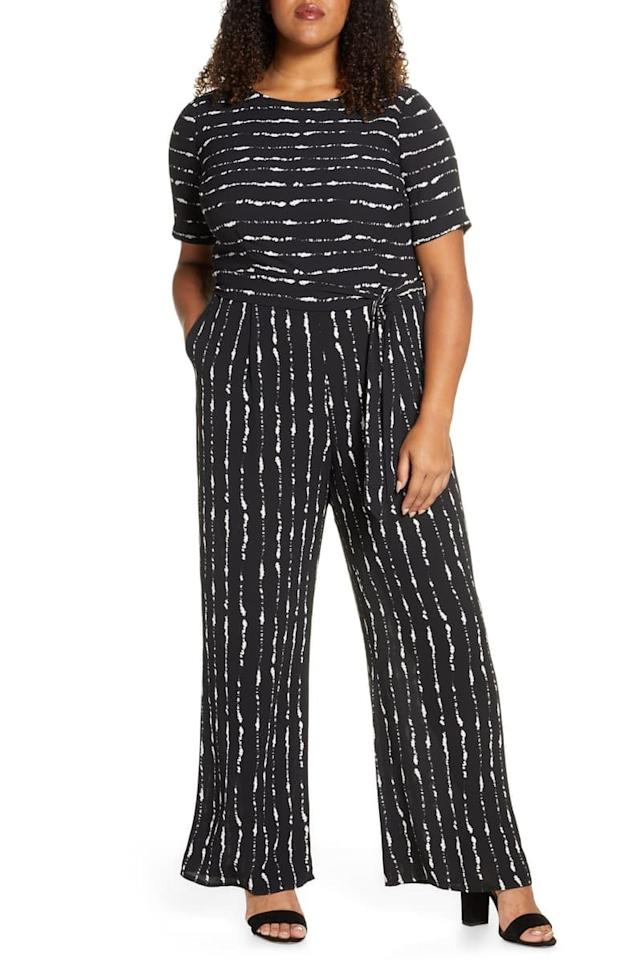 """<p>This <a href=""""https://www.popsugar.com/buy/Vince-Camuto-Impressions-Stripe-Belted-Jumpsuit-539029?p_name=Vince%20Camuto%20Impressions%20Stripe%20Belted%20Jumpsuit&retailer=shop.nordstrom.com&pid=539029&price=154&evar1=fab%3Aus&evar9=45860055&evar98=https%3A%2F%2Fwww.popsugar.com%2Fphoto-gallery%2F45860055%2Fimage%2F47093376%2FVince-Camuto-Impressions-Stripe-Belted-Jumpsuit&list1=shopping%2Cjumpsuits%2Cspring%20fashion%2Cwinter%20fashion&prop13=api&pdata=1"""" rel=""""nofollow"""" data-shoppable-link=""""1"""" target=""""_blank"""" class=""""ga-track"""" data-ga-category=""""Related"""" data-ga-label=""""https://shop.nordstrom.com/s/vince-camuto-impressions-stripe-belted-jumpsuit-plus-size/5475343/full?origin=category-personalizedsort&amp;breadcrumb=Home%2FWomen%2FClothing%2FJumpsuits%20%26%20Rompers&amp;color=rich%20black"""" data-ga-action=""""In-Line Links"""">Vince Camuto Impressions Stripe Belted Jumpsuit </a> ($154) includes a fun print.</p>"""