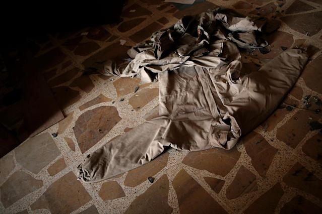 <p>Clothing left behind by Islamic State militants is seen on the floor in a compound used as a prison by Islamic State militants in the 17 Tamuz (July 17) district, in western Mosul, Iraq, June 6, 2017. (Alkis Konstantinidis/Reuters) </p>