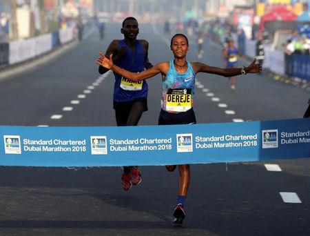 Roza Dereje Bekele of Ethiopia crosses the finish line of the Dubai Marathon, in Dubai, UAE January 26, 2018. REUTERS/Satish Kumar
