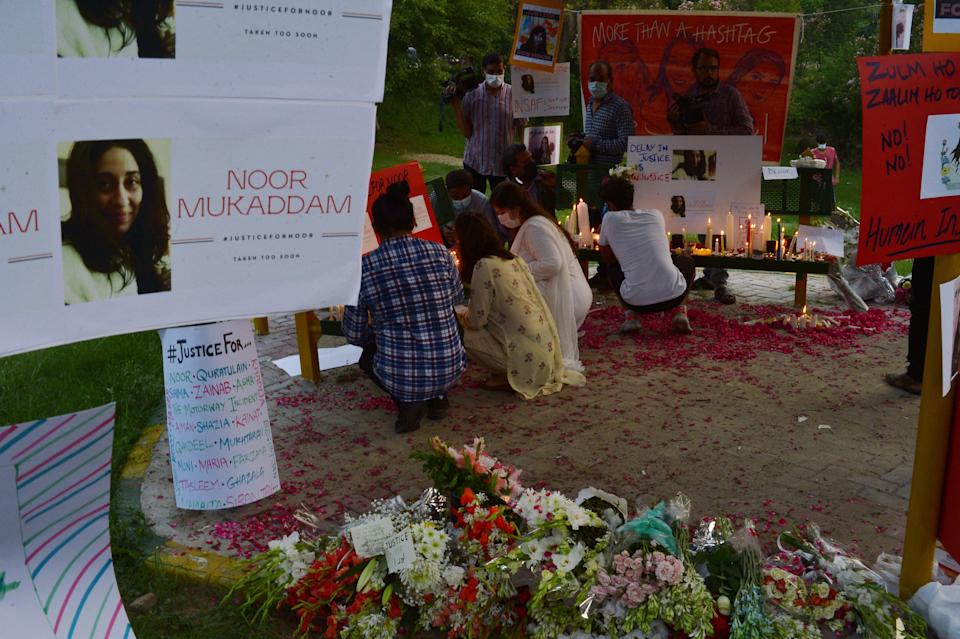 Women rights activists light candles at a park in Islamabad against the brutal killing of Noor Mukadam, the daughter of former Pakistan envoy to South Korea, in the federal capital last week (AFP via Getty Images)