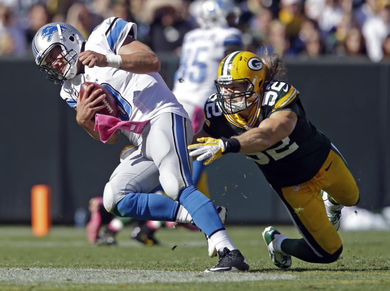 In this Sunday, Oct. 6, 2013, photo, Green Bay Packers' Clay Matthews, right, sacks Detroit Lions quarterback Matthew Stafford during the third quarter of an NFL football game in Green Bay, Wis. Matthews broke his right thumb during Sunday's 22-9 victory over the Detroit Lions on this play at Lambeau Field. (AP Photo/Jeffrey Phelps)