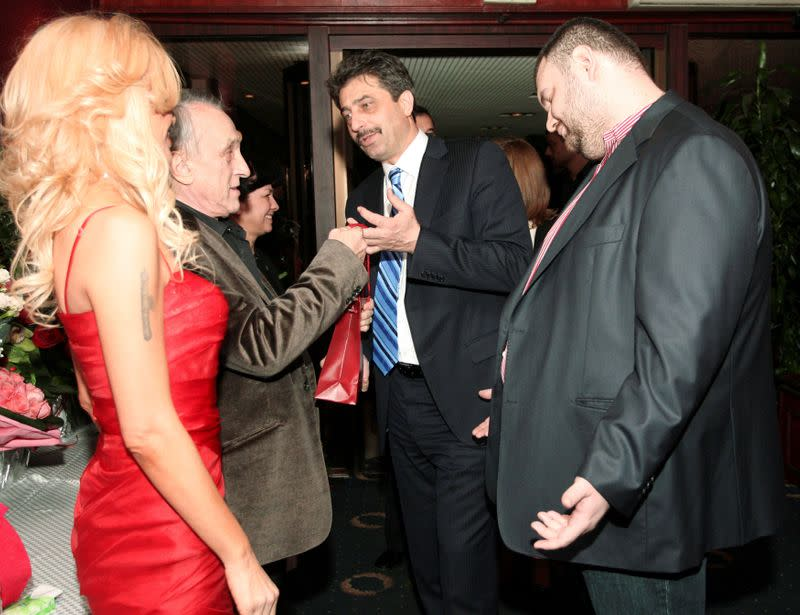 FILE PHOTO: Delyan Peevski (R), a Bulgarian businessman and former member of parliament, attends the birthday party of a newspaper publisher in Sofia