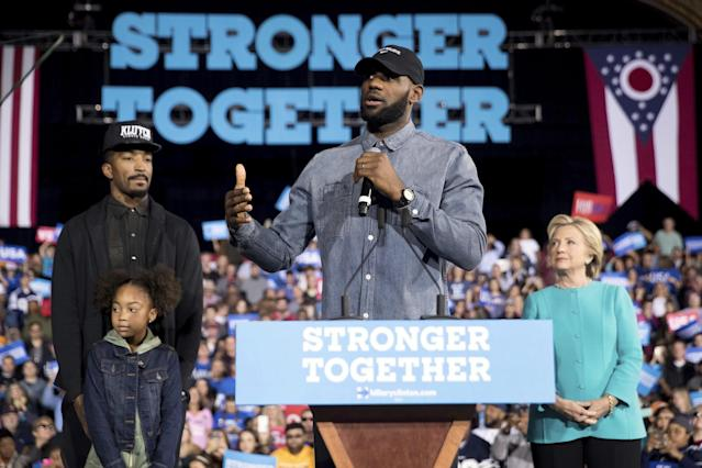 "LeBron James, center, accompanied by <a class=""link rapid-noclick-resp"" href=""/nba/teams/cle/"" data-ylk=""slk:Cleveland Cavaliers"">Cleveland Cavaliers</a> basketball player J. R. Smith, left, his daughter Demi, bottom left, and Democratic presidential candidate Hillary Clinton, right, speaks at a rally at the Cleveland Public Auditorium in Cleveland, Sunday, Nov. 6, 2016. (AP Photo/Andrew Harnik)"