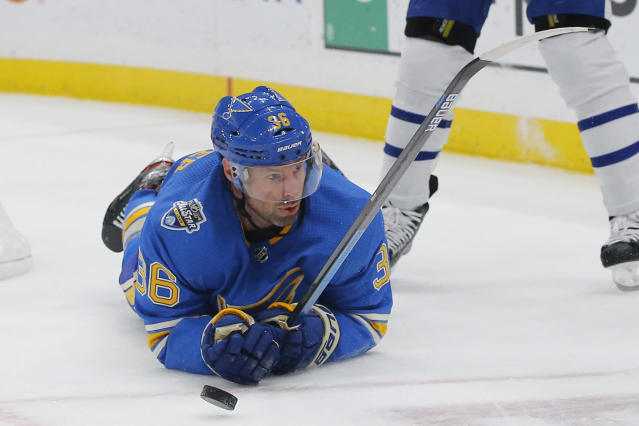 St. Louis Blues' Troy Brouwer looks for the puck after falling to the ice during the second period of an NHL hockey game against the Toronto Maple Leafs on Saturday, Dec. 7, 2019, in St. Louis. (AP Photo/Billy Hurst)