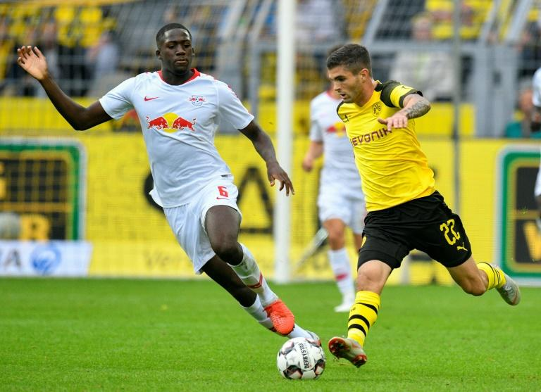 Dortmund's US midfielder Christian Pulisic, 19, (R) is set to make his 100th Bundesliga appearance at Hanover 96 on Friday