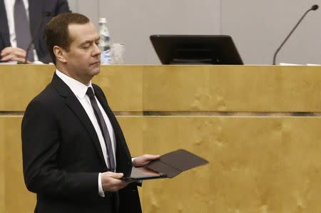 Russian PM Medvedev walks during session at State Duma in Moscow