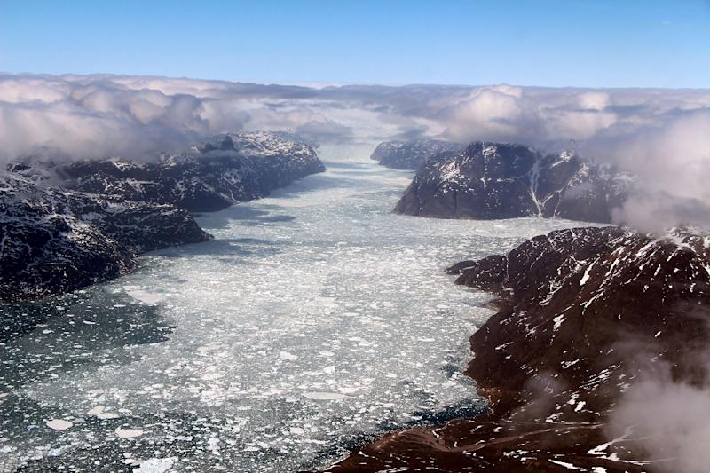 Using satellite imagery and climate models, scientists found that a reduction of just one percent of summer cloud cover translates to the thawing of 27 gigatons of ice in Greenland, equivalent to the annual domestic water supply of the United States (AFP Photo/John SONNTAG)