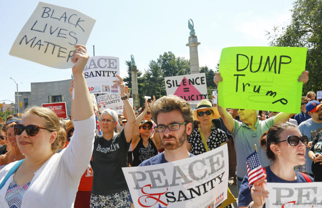 """<p>Protesters listen during a """"Peace and Sanity"""" rally Sunday Aug. 13, 2017, in New York, as speakers address white supremacy violence in Charlottesville, Va., yesterday. (AP Photo/Bebeto Matthews) </p>"""
