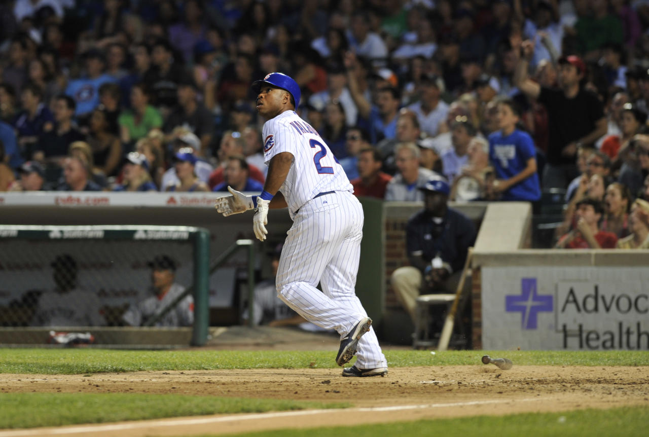 CHICAGO, IL - JUNE 16: Luis Valbuena #24 of the Chicago Cubs hits a three-run homer in the seventh inning against the Boston Red Sox  on June 16, 2012 at Wrigley Field in Chicago, Illinois.  (Photo by David Banks/Getty Images)