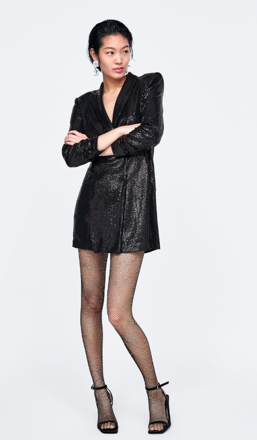 "<p>Blazer dresses have been a popular silhouette for 2018, so why not opt for this sparkly take from Zara? The look is available for $129 CAD and features a double breasted snap front enclosure.<br /><strong><a rel=""nofollow"" href=""https://www.zara.com/ca/en/shiny-blazer-dress-p02098560.html?v1=8100631&v2=1074622"">SHOP IT: ZARA, $129 </a></strong> </p>"