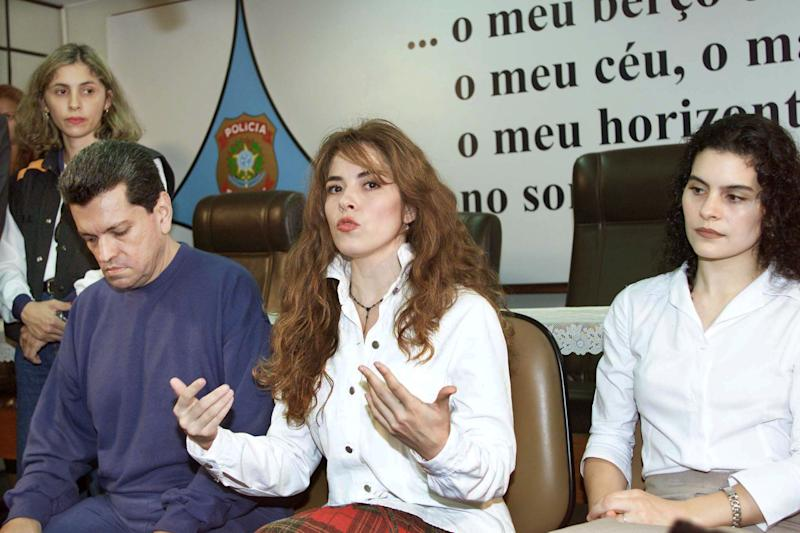 Former Mexican pop star Gloria Trevi (C) speaks alongside her manager Sergio Andrade (L) and backup singer Maria Raquenel Portillo during a news conference at Federal Police headquarters in Brasilia December 5, 2000. Teary-eyed and desperate, the fallen pop star made an impashioned plea to human rights groups to help her prove her innocence from sexual abuse charges just days ahead of her extradition hearing in Brazil. It was the first time the trio, who all face similar extradition hearings, spoke to the media since their arrest last January. JB