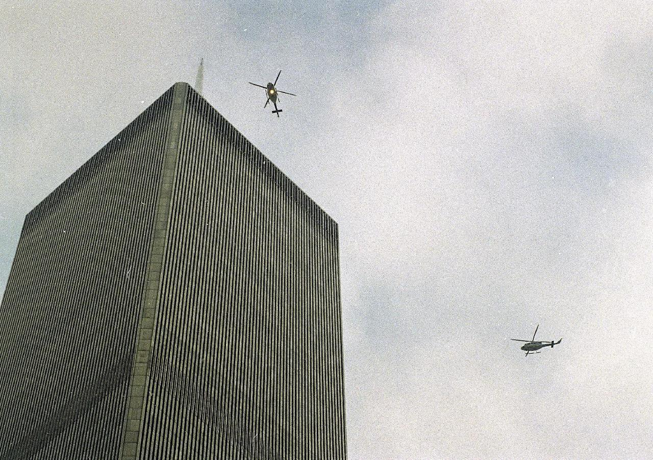 In this file photo of Feb. 26, 1993, helicopters jockey for position over the World Trade Center in New York following a noontime blast, which rocked the twin towers complex. Twenty years ago a group of terrorists blew up explosives in an underground parking garage under one of the towers, killing six people and ushering in an era of terrorism on American soil. (AP Photo/Ron Frehm, File)