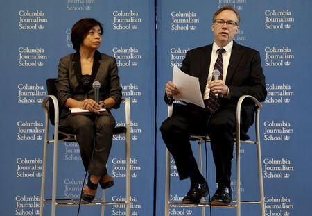 Columbia Journalism School Dean Steve Coll (R) and Dean of Academic Affairs Sheila Coronel appear at a news conference at Columbia University in New York April 6, 2015. REUTERS/Mike Segar