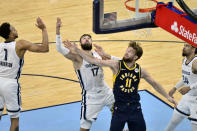 Indiana Pacers forward Domantas Sabonis (11) and Memphis Grizzlies center Jonas Valanciunas (17) reach for a rebound in the second half of an NBA basketball game Sunday, April 11, 2021, in Memphis, Tenn. (AP Photo/Brandon Dill)