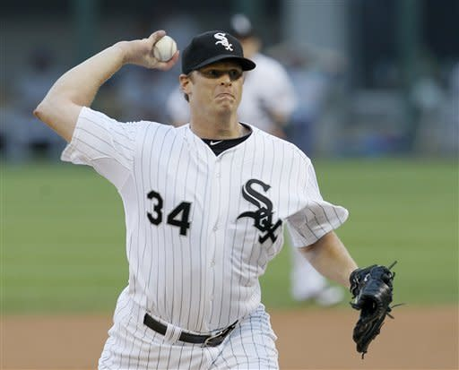 Chicago White Sox starting pitcher Gavin Floyd delivers during the first inning of an interleague baseball game against the Chicago Cubs, Wednesday, June 20, 2012, in Chicago. (AP Photo/Charles Rex Arbogast)