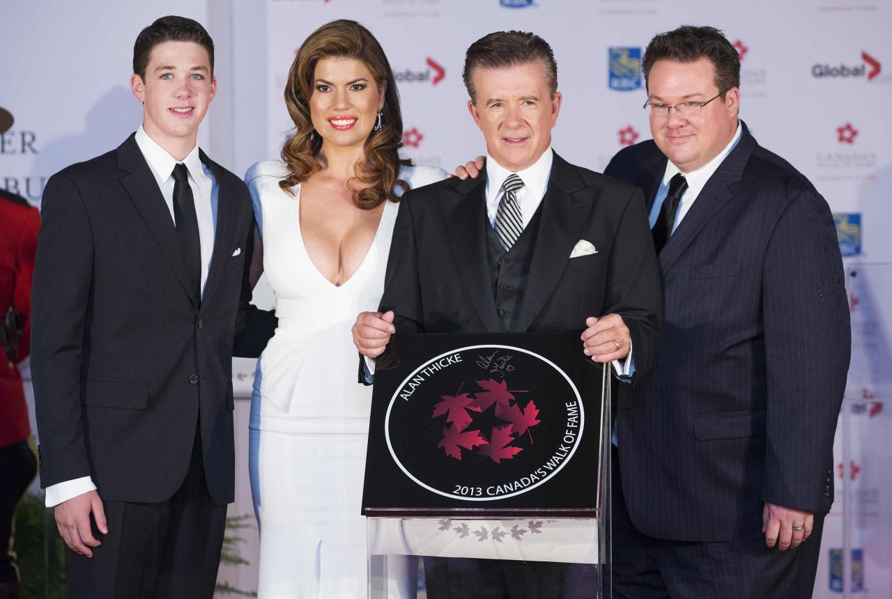 Actor Alan Thicke stands by his star with his wife Tanya Callau (2nd L), and sons Carter William Thicke (L) and Brennan Thicke (R) during Canada's Walk of Fame induction ceremonies in Toronto, September 21, 2013. REUTERS/Mark Blinch (CANADA - Tags: ENTERTAINMENT)