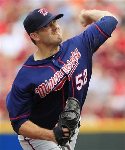 Minnesota Twins starting pitcher Brian Duensing throws against the Cincinnati Reds in the first inning of a baseball game on Saturday, June 23, 2012, in Cincinnati. (AP Photo/Al Behrman)