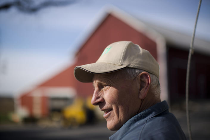 "Dennis Hess poses for a photograph at his farm Monday, Nov. 4, 2013, in Litiz, Pa. You can take our word for it: Americans don't trust each other anymore. An AP-GfK poll conducted last month found that Americans are suspicious of each other in everyday encounters. Less than a third expressed a lot of trust in clerks who swipe their credit cards, drivers on the road, or people they meet when traveling. However, there are still trusters around to set an example like Dennis Hess who runs an unattended farm stand on the honor system. Customers pick out their produce, tally their bills and drop the money into a slot, making change from an unlocked cashbox. ""When people from New York or New Jersey come up,"" said Hess, ""they are amazed that this kind of thing is done anymore."" (AP Photo/Matt Rourke)"