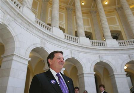 Former House Majority leader U.S. Representative Tom Delay (R-TX) walks out of the Cannon House office building on Capitol Hill on the day his resignation takes effect in Washington