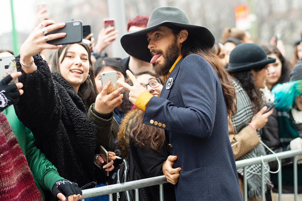 Jared Leto stops for photos with fans while leaving the Gucci fashion show during Milan Fashion Week in Italy on Tuesday.