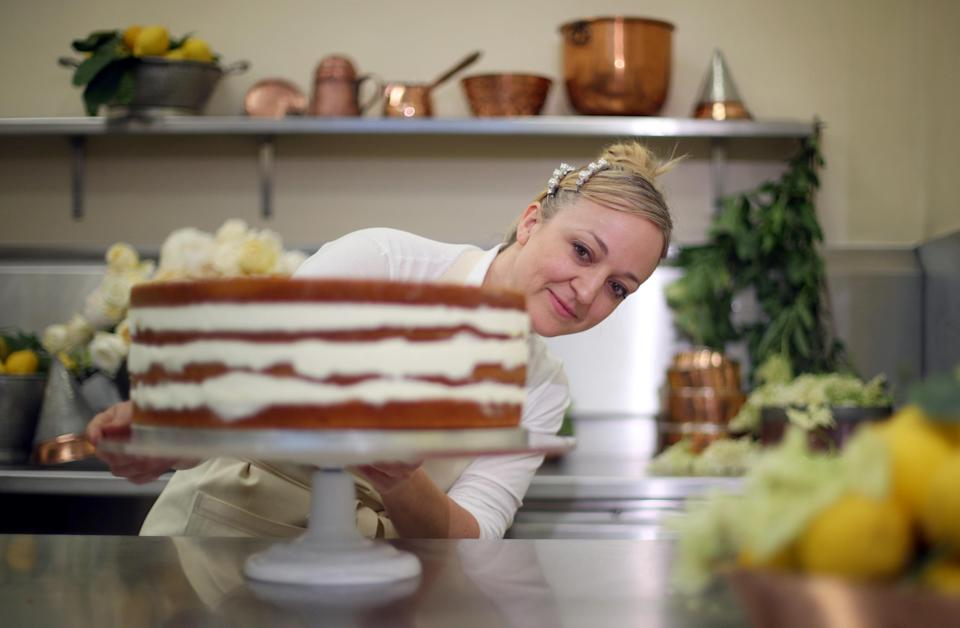 Claire Ptak ices the famous cake. [Photo: PA]