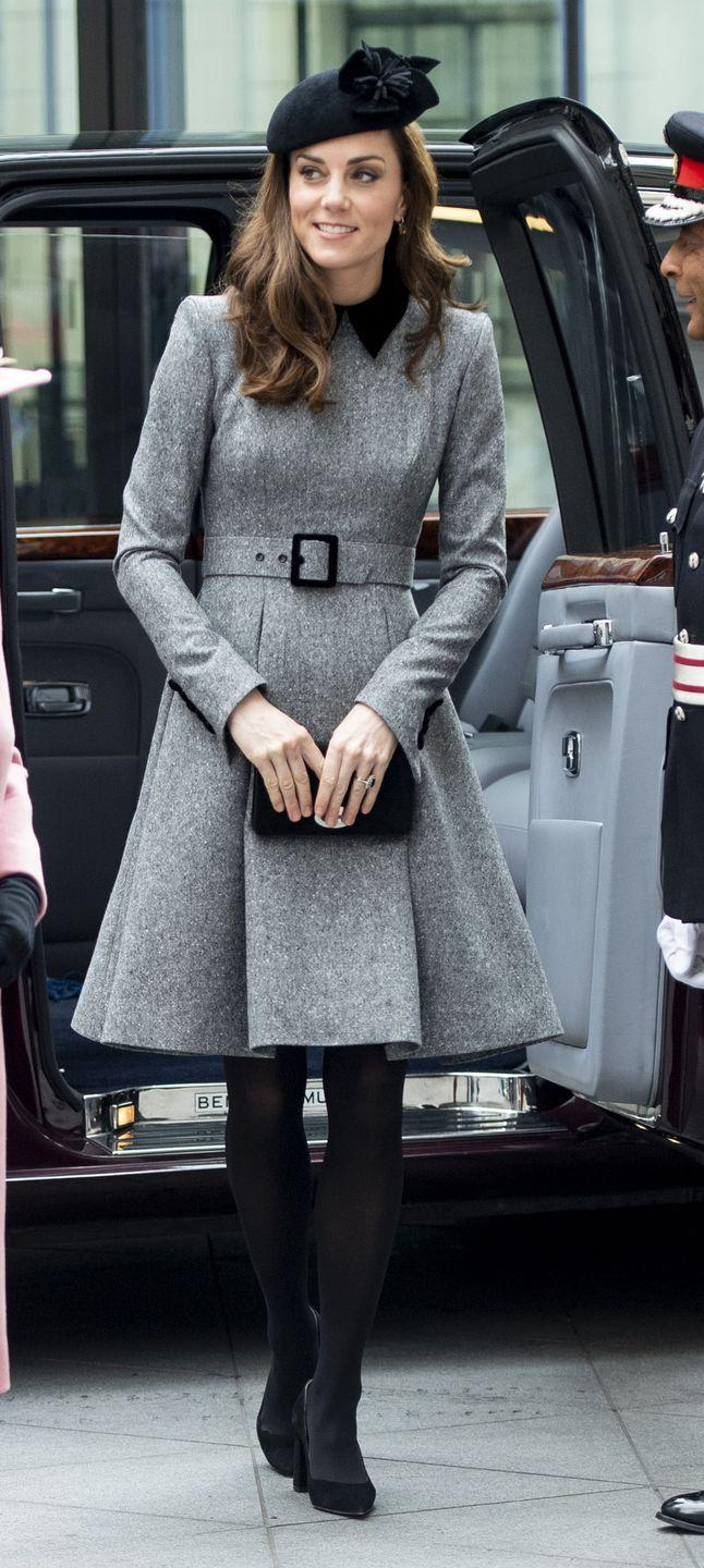 <p>The Duchess of Cambridge arrived at Kings College London wearing a gray Catherine Walker Coat Dress with black trim. She paired the look with black tights and pumps and a Sylvia Fletcher for Lock Hatters hat. She also carried a small black clutch.</p>