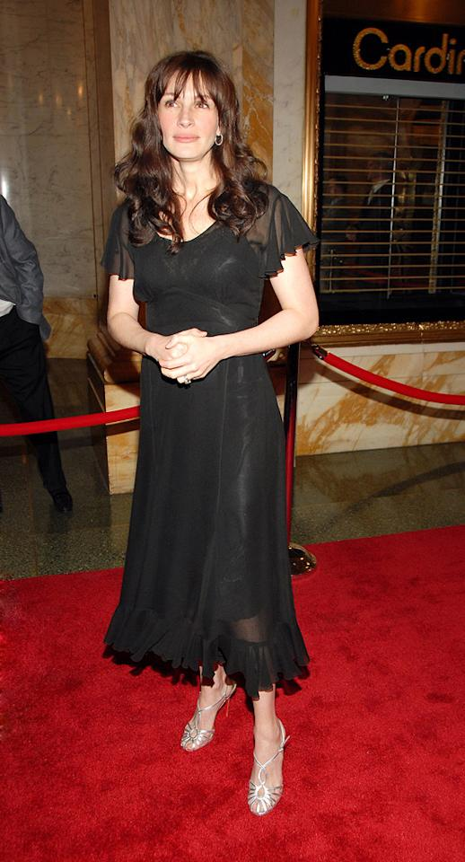 "9. ""Three Days of Rain"" NY premiere (2006)   Julia is known for wearing boring black to nearly every event, but this particular dress isn't just dull; it's matronly; it doesn't properly hide her slip, and those frilly cap sleeves and hem are simply horrifying. And don't get me started on those bangs."