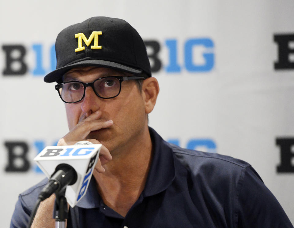 Would Michigan head coach Jim Harbaugh consider another stint in the NFL? (AP)
