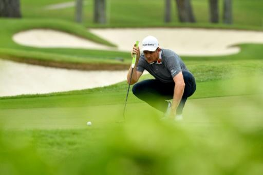 Justin Rose of England lining up a putt at the Singapore Open