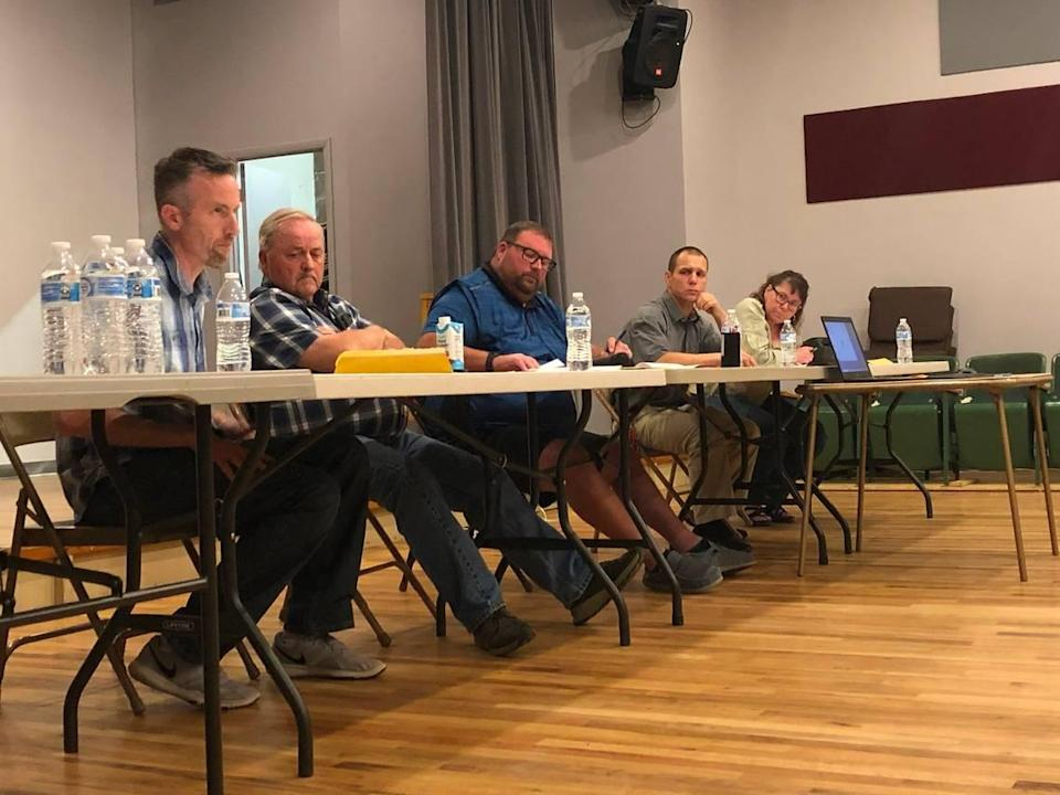 From left, Melba City Council members Chris Hinderliter and Hal Forsgren, Mayor Cory Dickard, the council members Tyler Stapleton and Jeannine Johnshoy discuss enacting an emergency moratorium that would halt the processing of land divisions in Melba.
