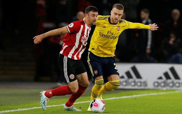 Sheffield United's Enda Stevens in action with Arsenal's Calum Chambers - REUTERS