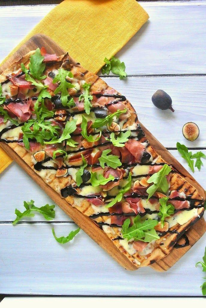 """<p>This sweet flatbread would go perfectly with a cheese plate and a glass of wine.</p><p>Get the recipe at <a href=""""http://culinaryginger.com/grilled-flatbread-with-figs-prosciutto/"""" rel=""""nofollow noopener"""" target=""""_blank"""" data-ylk=""""slk:Culinary Ginger"""" class=""""link rapid-noclick-resp"""">Culinary Ginger</a>.</p>"""