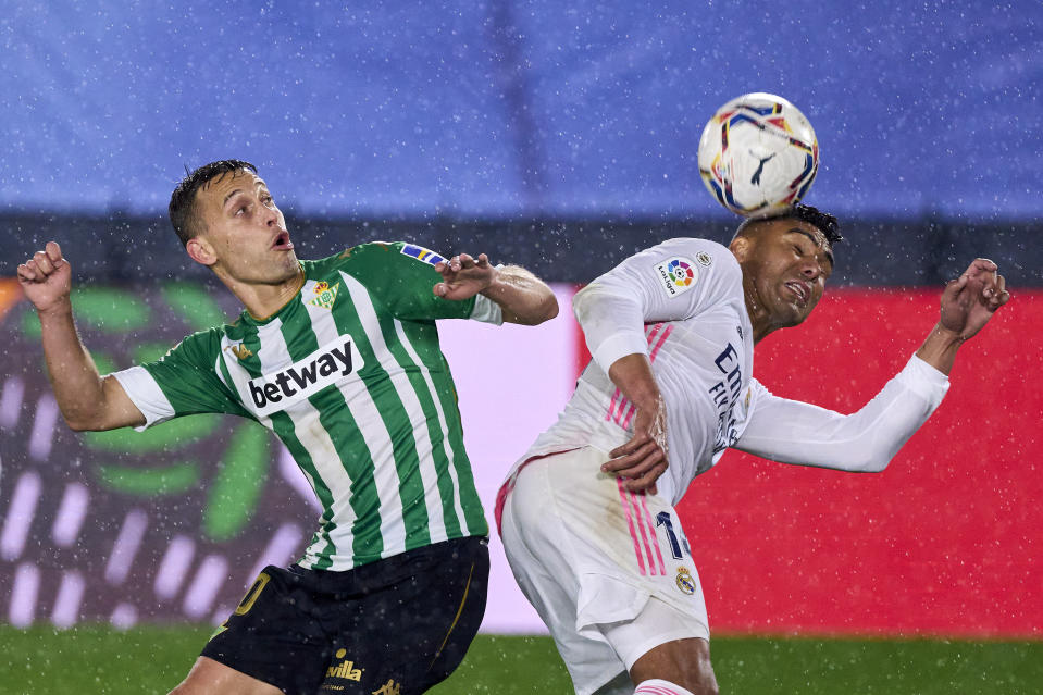 MADRID, SPAIN - APRIL 24: Casemiro of Real Madrid battle for the ball with Sergio Canales Real Betis during the La Liga Santander match between Real Madrid and Real Betis at Estadio Alfredo Di Stefano on April 24, 2021 in Madrid, Spain. Sporting stadiums around Spain remain under strict restrictions due to the Coronavirus Pandemic as Government social distancing laws prohibit fans inside venues resulting in games being played behind closed doors. (Photo by Diego Souto/Quality Sport Images/Getty Images)