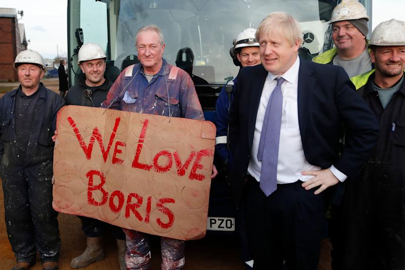 Boris Johnson poses with workers during a visit to Wilton Engineering Services in the 'red wall' area of Middlesbrough, on November 20 (Photo: ASSOCIATED PRESS)