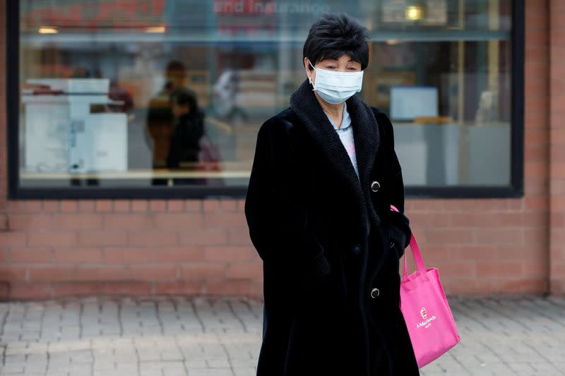A woman wears a mask following the outbreak of the novel coronavirus, in Chicago