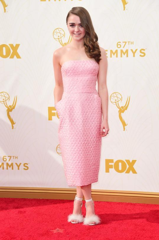 <p>Maisie Williams's pink dress looked a quilt but who cares because she looked so sweet in the bubblegum piece. Even more fun than the midi dress itself were her accessories, wearing furry peep toe heels and carrying a clutch in the shape of a penguin wearing a tuxedo. </p>