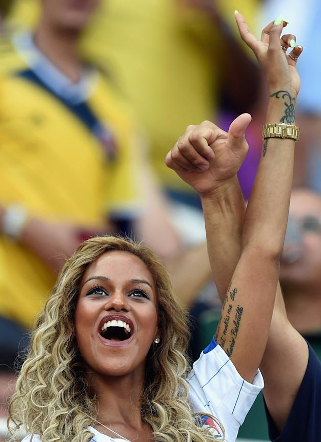 MANAUS, BRAZIL - JUNE 14: Fanny Neguesha, fiancee of Mario Balotelli of Italy, cheers in the crowd during the 2014 FIFA World Cup Brazil Group D match between England and Italy at Arena Amazonia on June 14, 2014 in Manaus, Brazil. (Claudio Villa/Getty Images)