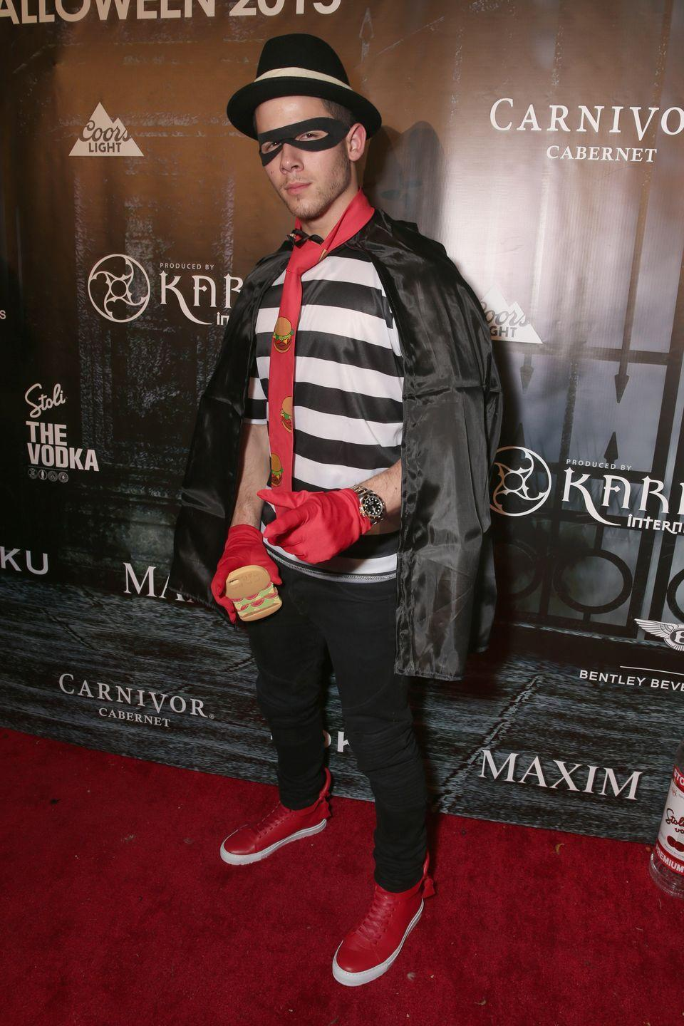 """<p>You don't have to be a hamburger lover to love this McDonald's Hamburglar costume. Just get your hands on a black-and-white striped shirt, a bandit mask, a fedora, and some red accessories. </p><p><a class=""""link rapid-noclick-resp"""" href=""""https://www.amazon.com/Zorro-Mask-Costume-Accessories-pack/dp/B00L2OZ71U?tag=syn-yahoo-20&ascsubtag=%5Bartid%7C10070.g.28171554%5Bsrc%7Cyahoo-us"""" rel=""""nofollow noopener"""" target=""""_blank"""" data-ylk=""""slk:SHOP BANDIT MASK"""">SHOP BANDIT MASK</a></p>"""