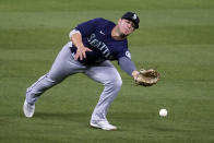 Seattle Mariners second baseman Ty France reaches for but can't catch a fly ball from Los Angeles Dodgers' Will Smith during the fourth inning of a baseball game Wednesday, May 12, 2021, in Los Angeles. Smith singled on the play. (AP Photo/Marcio Jose Sanchez)