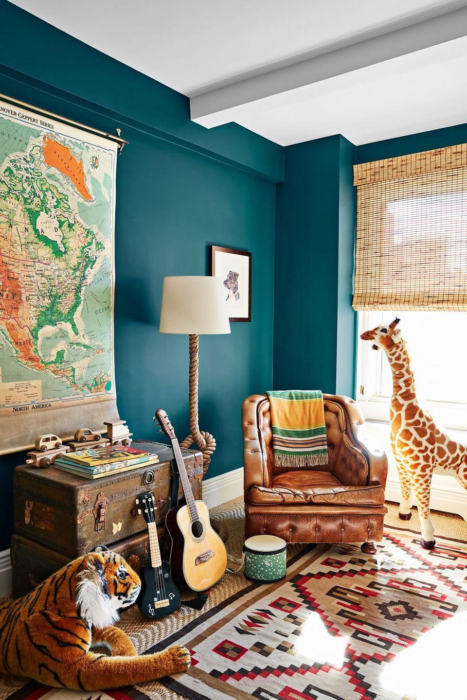 <p>Instill a sense of wonder and exploration early on with educational wall art (like maps) and storied collectables, like antique trunks that double a storage units. The bonus? Since storage is one thing you know you'll always need, they'll last and age with your child. In this child's room designed by Starrett Zenko Ringbom, the timeless pieces—like the ottoman and floor lamp—give the room a refined edge that will age well. And those stacked antique trunks bring in both character and extra storage for toys.</p>