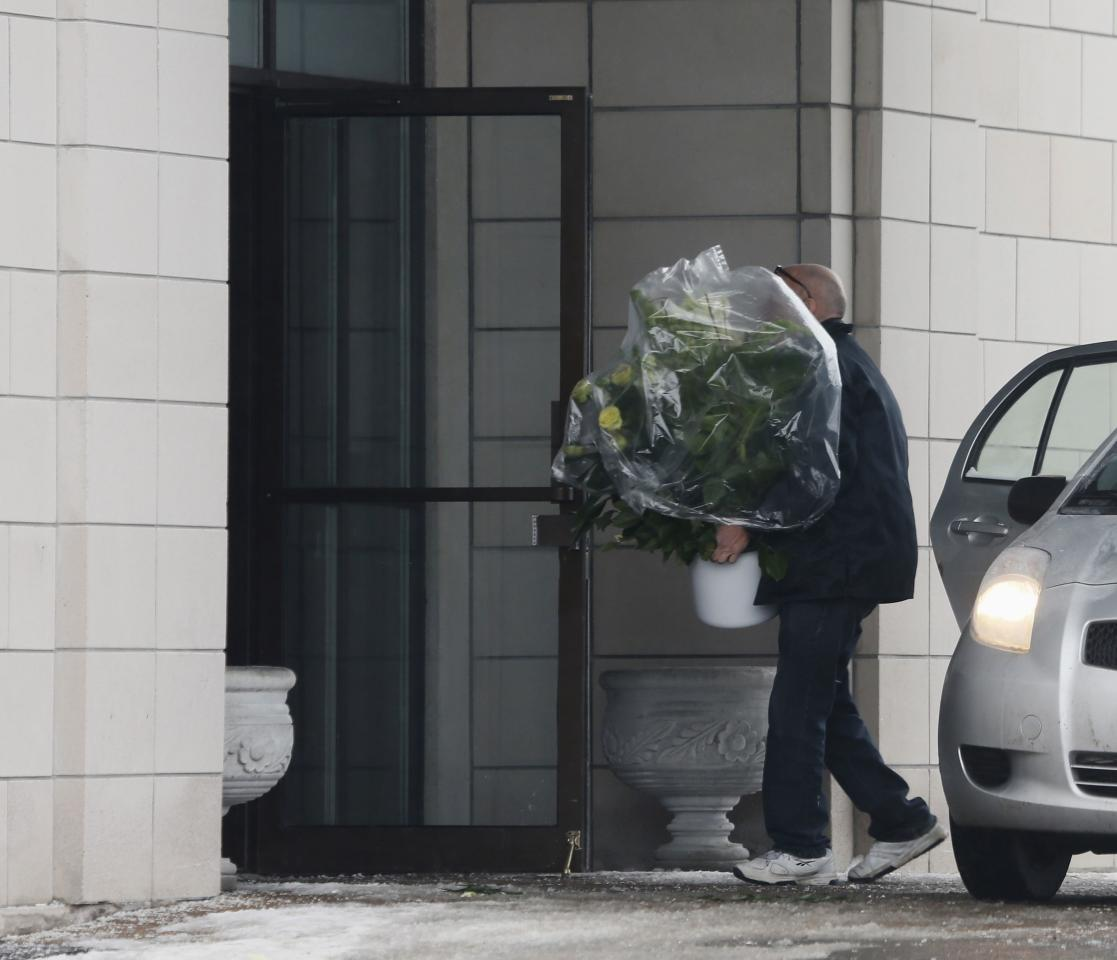 Flowers are brought to the funeral home prior to the visitation for Vito Rizzuto, head of the infamous Rizzuto crime family, in Montreal December 29, 2013. Rizzuto died of natural causes in a hospital on December 23, 2013. REUTERS/Christinne Muschi (CANADA - Tags: CRIME LAW OBITUARY SOCIETY)